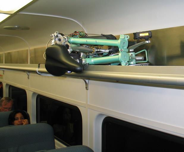 mini-folding-bike-overhead-bin-njt-train.jpg